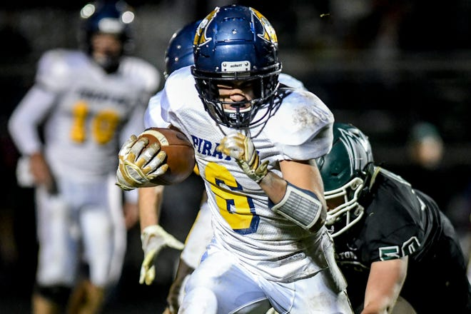 Pewamo-Westphalia's Tanner Wirth runs for a gain during the second quarter on Friday, Oct. 25, 2019, in Williamston.
