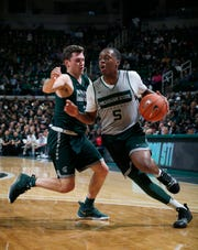 Michigan State's Cassius Winston, right, drives against Foster Loyer during the NCAA college basketball team's scrimmage Friday, Oct. 25, 2019, in East Lansing, Mich.