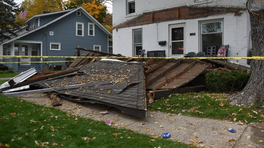 A rental property in the 200 block of Elm Street near Center in East Lansing, pictured Saturday, Oct. 26, 2019, after a porch roof with people on it fell.  Officials say five were injured, one was taken to the hospital with non life-threatening injuries.