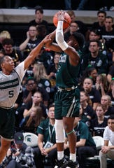 Michigan State's Rocket Watts, right, shoots against Cassius Winston during an NCAA college basketball scrimmage, Friday, Oct. 25, 2019, in East Lansing, Mich.