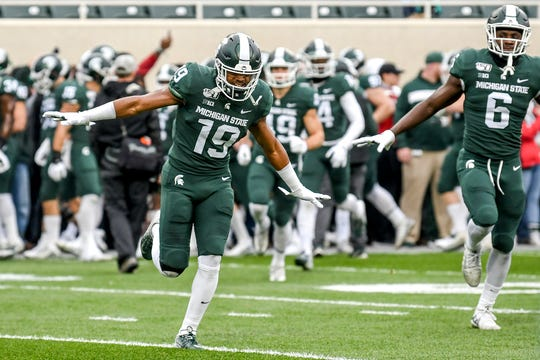 Michigan State defensive players Josh Butler, left, and David Dowell get hyped up before the Spartans game against Penn State on Saturday, Oct. 26, 2019, at Spartan Stadium in East Lansing.