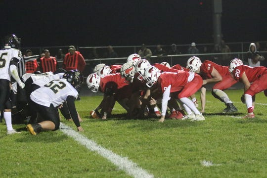 Plymouth's offensive line helped the Big Red pile up 345 yards of rushing offensive scoring seven touchdowns on the ground in a 52-39 win over South Central.