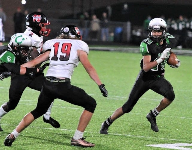 Clear Fork's Tacoma Orr bounces to the outside with one of his six catches in the Colts' 55-20 win over Marion Harding