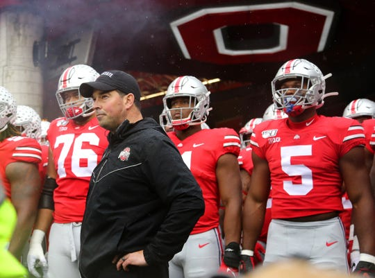 Ohio State coach Ryan Day waits to take the field with his Buckeyes before raising his record to 11-0 as head coach with Saturday's 38-7 win over Wisconsin.