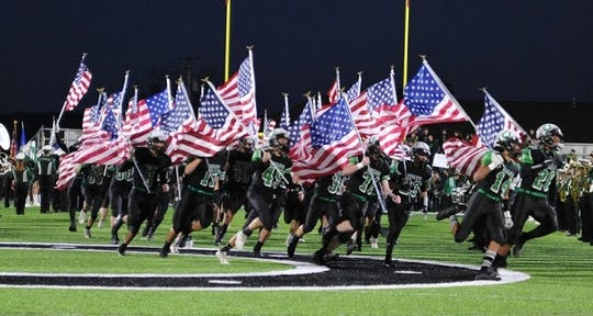The Clear Fork Colts football team came storming onto the field waving American flags before their 55-20 win over Harding last week.