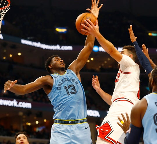 Memphis Grizzlies forward Jaren Jackson Jr. leaps up to defend a shot by Chicago Bulls guard Zach LaVine during the home opener at the FedExForum on Friday, Oct. 25, 2019.
