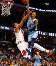 Memphis Grizzlies guard Ja Morant tries to dunk over Chicago Bulls forward Wendell Carter Jr. during the home opener at the FedExForum on Friday, Oct. 25, 2019.