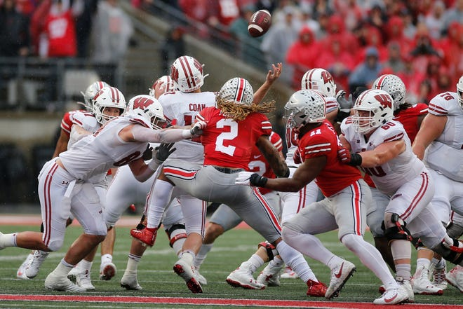 Ohio State defensive end Chase Young (2) causes UW quarterback Jack Coan to fumble the ball on a fourth down play during the second half.
