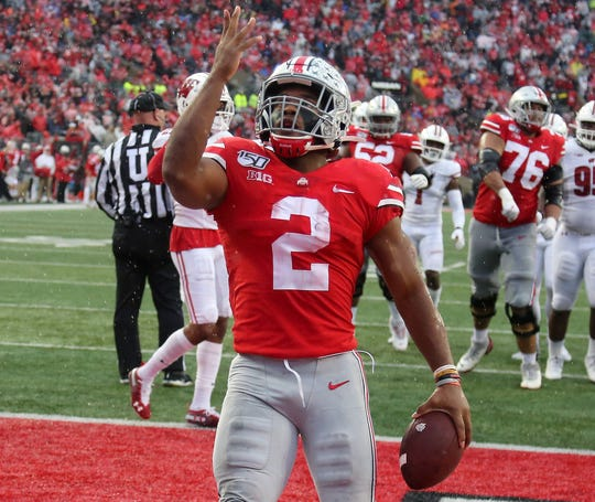 Ohio State running back J.K. Dobbins celebrates a touchdown during the third quarter against Wisconsin at Ohio Stadium.