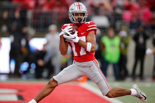 Ohio State receiver Chris Olave hauls in a 27-yard touchdown pass against the Badgers with just 43 seconds remaining before halftime.