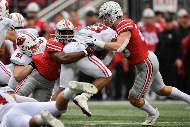 UW star running back Jonathan Taylor found little room to run against the Buckeyes defense Saturday. Taylor gained just 52 yards in 20 carries.