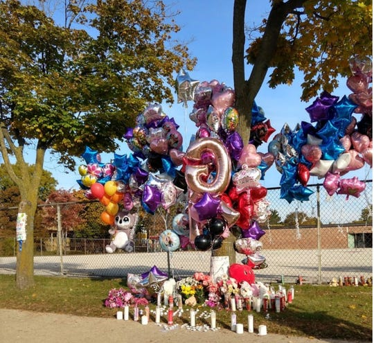 A remembrance in front of Gwen T. Jackson Early Childhood and Elementary School after a hit-and-run driver killed a 6-year-old girl while she crossing West Center Street at North 22nd Street.
