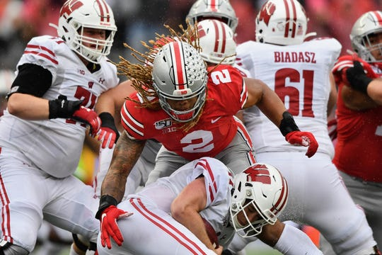 Ohio State defensive end Chase Young collects one of his four quarterback sacks against the Badgers.