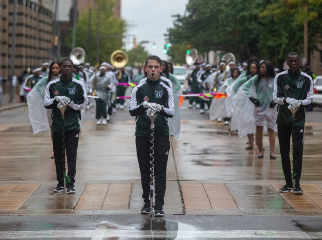 Jeff Davis High School lead drum major Justin Heideman leads the band during a performance at the annual Magic City Classic parade in downtown Birmingham on October 26.