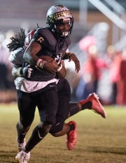 Muscle Shoals' Malik Smith (32) stops Wetumpka's quarterback Tyquan Rawls (6) at Hohenberg Stadium in Wetumpka, Ala., on Friday October 25, 2019.