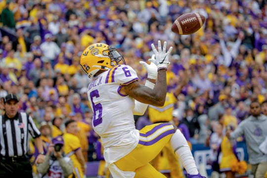 Oct 26, 2019; Baton Rouge, LA, USA; LSU Tigers wide receiver Terrace Marshall Jr. (6) catches a touchdown against the Auburn Tigers during the first half at Tiger Stadium. Mandatory Credit: Derick E. Hingle-USA TODAY Sports
