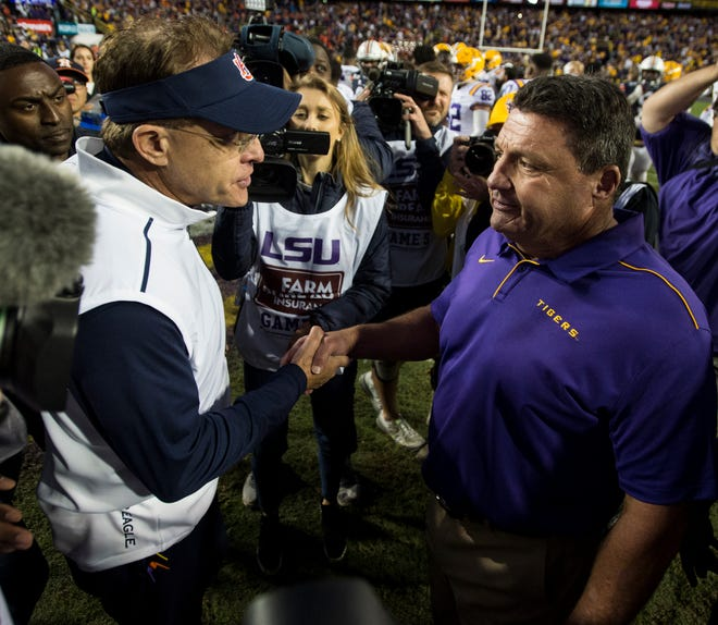 Auburn head coach Gus Malzahn and LSU head coach Ed Orgeron shake hands after the game at Tiger Stadium in Baton Rouge, La., on Saturday, Oct. 26, 2019. LSU defeated Auburn 23-20.