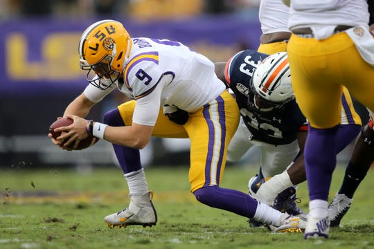 Oct 26, 2019; Baton Rouge, LA, USA; LSU Tigers quarterback Joe Burrow (9) is sacked by Auburn Tigers linebacker K.J. Britt (33) in the first quarter at Tiger Stadium. Mandatory Credit: Chuck Cook-USA TODAY Sports