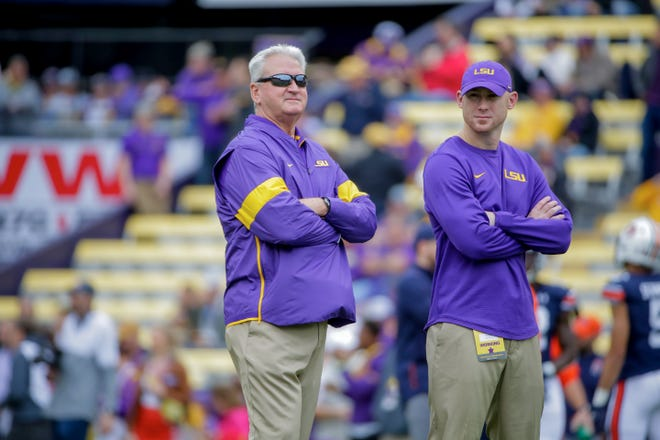 Oct 26, 2019; Baton Rouge, LA, USA; LSU Tigers offensive coordinator Steve Ensminger and passing game coordinator Joe Brady (right) watch during warm ups prior to kickoff against the Auburn Tigers at Tiger Stadium. Mandatory Credit: Derick E. Hingle-USA TODAY Sports
