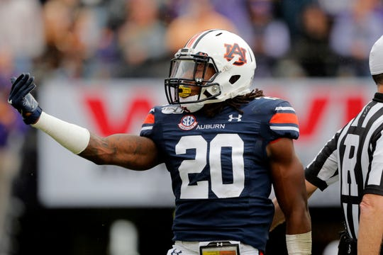 Auburn defensive back Jeremiah Dinson (20) gestures against LSU in Baton Rouge, La., Saturday, Oct. 26, 2019.