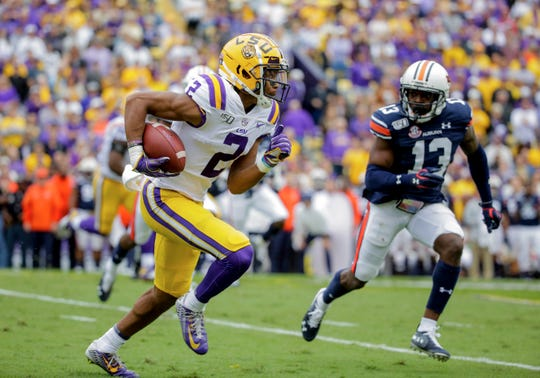 Oct 26, 2019; Baton Rouge, LA, USA; LSU Tigers wide receiver Justin Jefferson (2) runs past Auburn Tigers defensive back Javaris Davis (13) during the first quarter at Tiger Stadium. Mandatory Credit: Derick E. Hingle-USA TODAY Sports