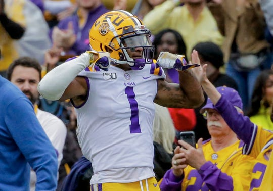 Oct 26, 2019; Baton Rouge, LA, USA; LSU Tigers wide receiver Ja'Marr Chase (1) reacts after a reception against the Auburn Tigers during the first half at Tiger Stadium. Mandatory Credit: Derick E. Hingle-USA TODAY Sports
