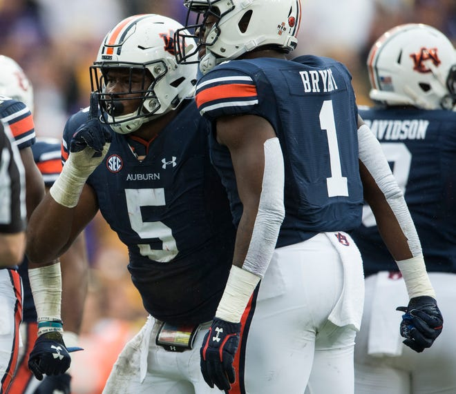 Auburn defensive lineman Derrick Brown (5) celebrates after making a stop in the backfield at Tiger Stadium in Baton Rouge, La., on Saturday, Oct. 26, 2019. Auburn and LSU are tied 10-10 at halftime.