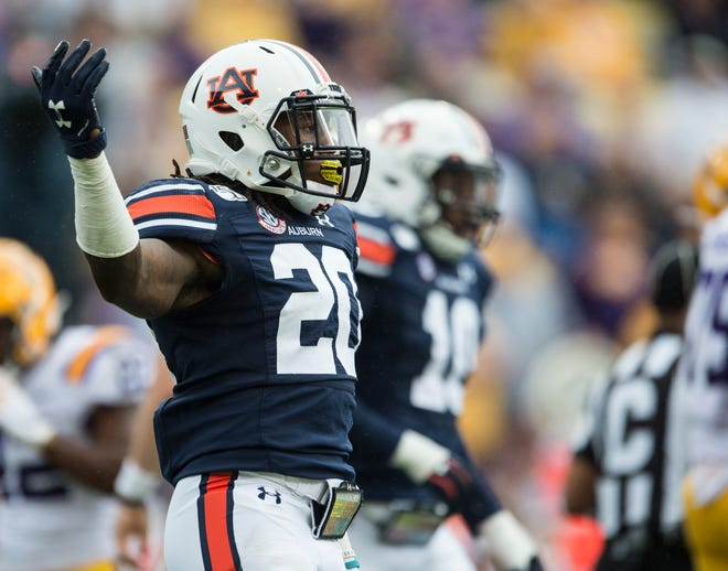 Auburn defensive back Jeremiah Dinson (20) celebrates after helping make a stop in the backfield at Tiger Stadium in Baton Rouge, La., on Saturday, Oct. 26, 2019.