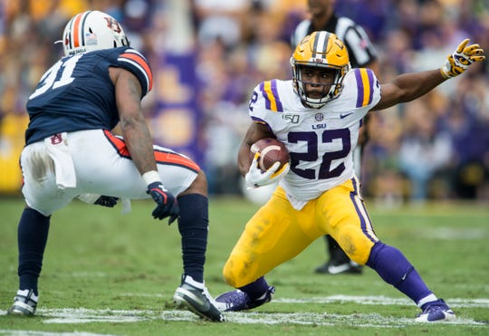 LSU running back Clyde Edwards-Helaire (22) jukes Auburn linebacker Chandler Wooten (31) at Tiger Stadium in Baton Rouge, La., on Saturday, Oct. 26, 2019. Auburn and LSU are tied 10-10 at halftime.