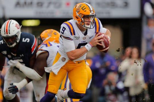 LSU quarterback Joe Burrow (9) scrambles in the first half of an NCAA college football game against Auburn in Baton Rouge, La., Saturday, Oct. 26, 2019. (AP Photo/Gerald Herbert)