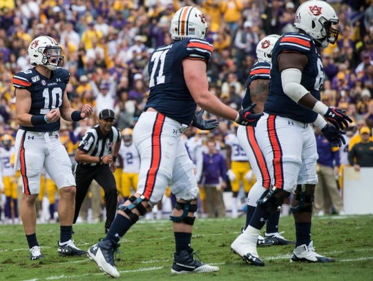Auburn quarterback Bo Nix (10) shows his frustration after his offensive line is called for a false start penalty at Tiger Stadium in Baton Rouge, La., on Saturday, Oct. 26, 2019.