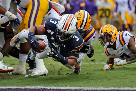 Auburn running back D.J. Williams (3) is stopped short of the goal line during the first half of an NCAA college football game against LSU in Baton Rouge, La., Saturday, Oct. 26, 2019.