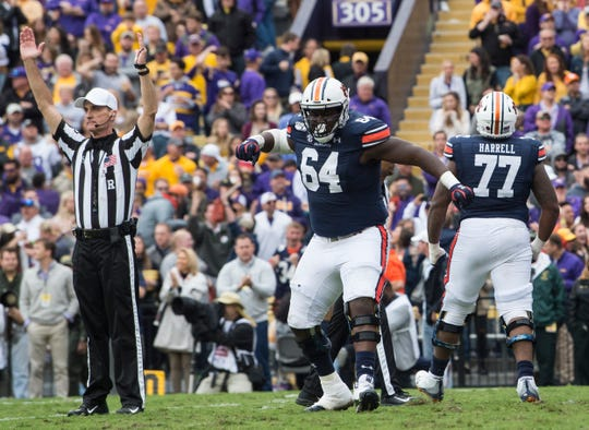 Auburn offensive lineman Mike Horton (64) and Marquel Harrell (77) celebrate after quarterback Bo Nix (10) sneaks in for a touchdown at Tiger Stadium in Baton Rouge, La., on Saturday, Oct. 26, 2019.