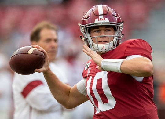 Alabama quarterback Mac Jones (10) warms up as head coach Nick Saban looks on at Bryant-Denny Stadium in Tuscaloosa, Ala., on Saturday October 26, 2019.