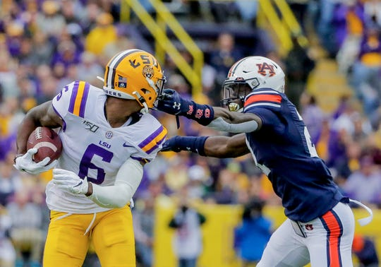 Oct 26, 2019; Baton Rouge, LA, USA; Auburn Tigers defensive back Smoke Monday (21) pulls the facemask of LSU Tigers wide receiver Terrace Marshall Jr. (6) during the first half at Tiger Stadium. Mandatory Credit: Derick E. Hingle-USA TODAY Sports