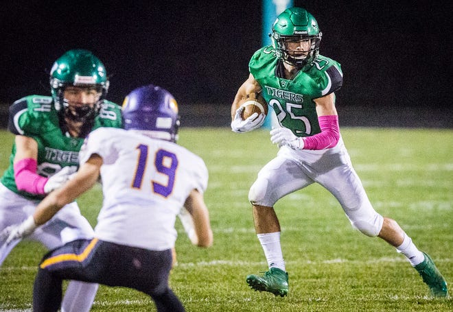 Yorktown's Austin Hill runs the ball against Guerin Catholic's defense during their game at Yorktown High School Friday, Oct. 25, 2019.
