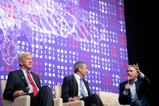 Former Illinois Rep. Joe Walsh, former South Carolina Gov. Mark Sanford and former Massachusetts Gov. Bill Weld speak on a panel together during Politicon in October in Nashville. Sanford has since dropped out of the GOP presidential primary race.
