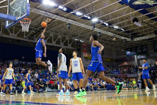 FGCU freshman Jalen Harper slams it down in the team scrimmage during Dunk City After Dark.