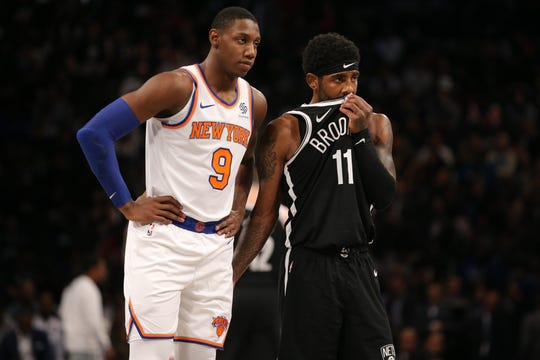 Oct 25, 2019; Brooklyn, NY, USA; Brooklyn Nets point guard Kyrie Irving (11) talks to New York Knicks small forward RJ Barrett (9) during the third quarter at Barclays Center.