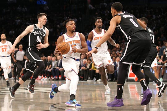 Oct 25, 2019; Brooklyn, NY, USA; New York Knicks point guard Dennis Smith Jr. (5) drives the lane against Brooklyn Nets point guard Spencer Dinwiddie (8) during the first quarter at Barclays Center.