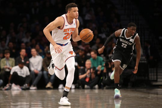 Oct 25, 2019; Brooklyn, NY, USA; New York Knicks small forward Kevin Knox II (20) controls the ball against Brooklyn Nets shooting guard Caris LeVert (22) during the second quarter at Barclays Center.