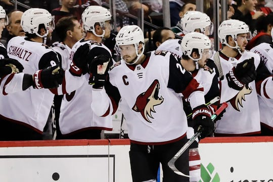 Arizona Coyotes' Oliver Ekman-Larsson (23) celebrates with teammates after scoring a goal during the second period of the team's NHL hockey game against the New Jersey Devils on Friday, Oct. 25, 2019, in Newark, N.J.