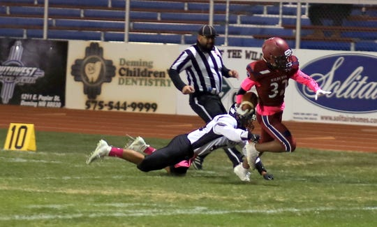 Junior Jordan Caballero (32) breaks a tackle on his way to a 58-yard touchdown run Friday against Chaparral.