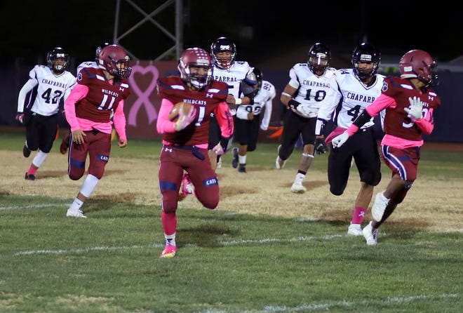 Senior Wildcat Jesse Varela (foreground) put the Chaparral Lobos in his rear-view mirror during a 90-yard kick return for a touchdown. The Deming Wildcats went on to a 52-7 victory in District 3-5A football.