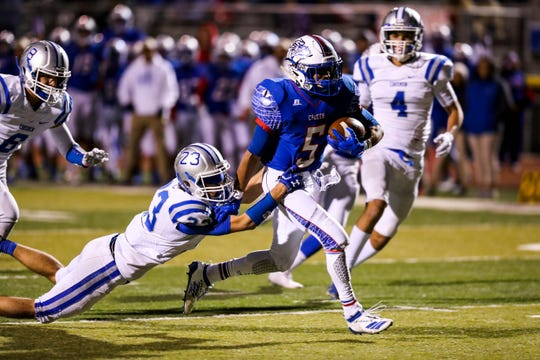 Senior running back  Johnny Terrazas (5) runs the ball for a touchdown as the Las Cruces Bulldawgs face off against the Carlsbad Cavemen at The Field of Dreams in Las Cruces on Friday, Oct. 25, 2019.