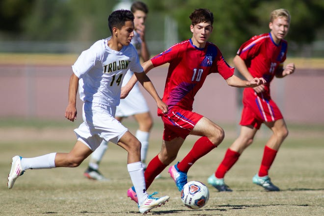 Marcos Cortez of Mayfield High School goes against Las Cruces High's Gael Pena on Saturday at the Field of Dreams Soccer Complex.