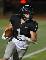 Plymouth Wildcat running back Mike Mathias picks up some yards against Belleville.