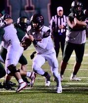Churchill quarterback Gavin Brooks scores a touchdown. Livonia Churchill beats Howell 27-0 on Oct. 25