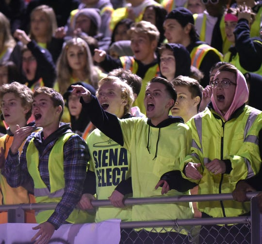 Plymouth High Wildcat fans react to penalties called against both teams during the game.