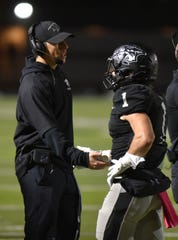 Plymouth High Wildcat head coach Brian Lewis welcomes Mike Mathias back to the sideline.